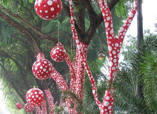 "Yayoi Kusama's ""Ascension of Polkadots in the Trees"", 2006, via Wikimedia Commons"