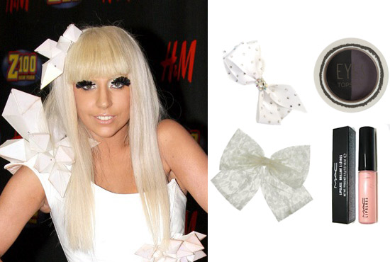 Lady Gaga with nude lips, dark eyelashes, and a white hair bow