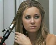 Lauren Conrad curling her hair with a curling iron