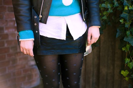 Leather skirt and patterned tights college style trends