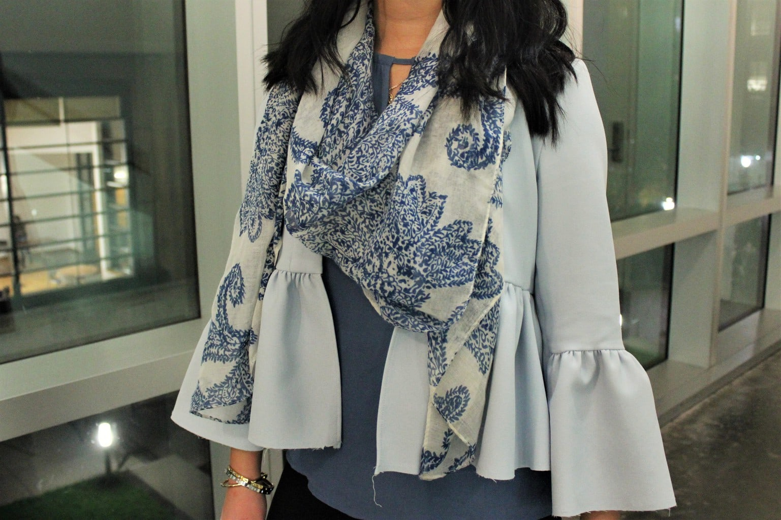 Catherine's baby blue peplum jacket also has bell sleeves, which she pairs with a blue and white paisley scarf.