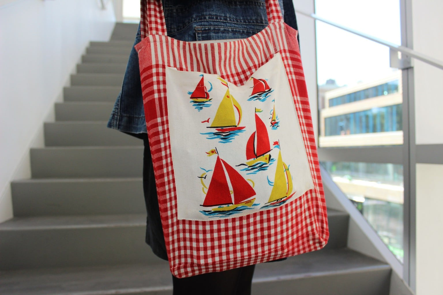 This red and white gingham totebag has a sailboat pattern.