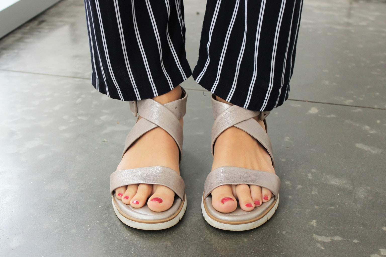 Strappy silver sandals finish off Maya's look.