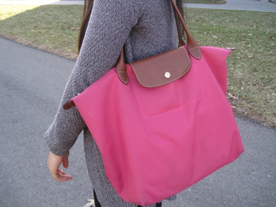 college student with Longchamp bag