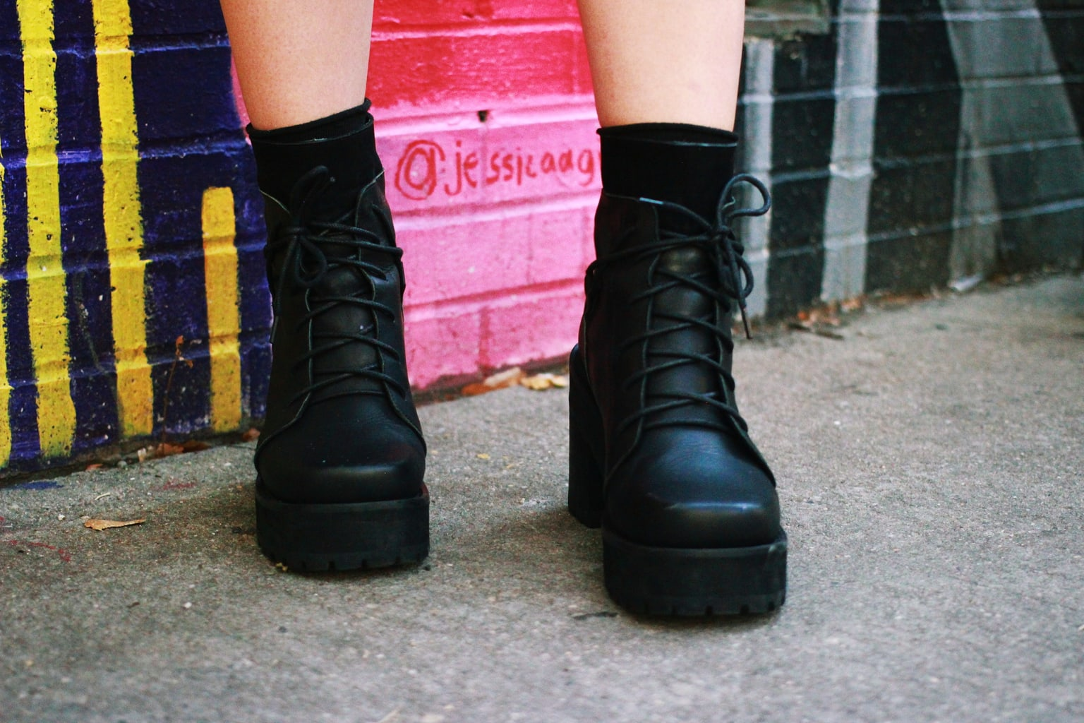 Chunky punk black lace-up boots add to this Fashion Institute of Technology student's overall attire.