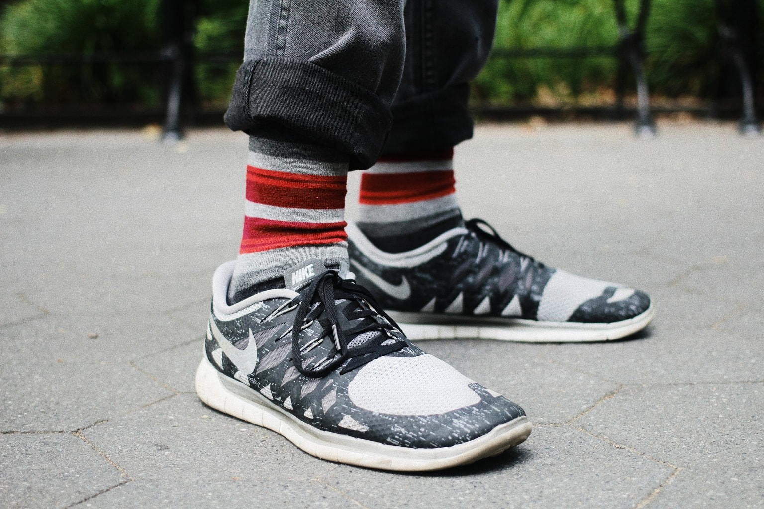 Guy's fashion in college: Nike sneakers and red and white striped socks