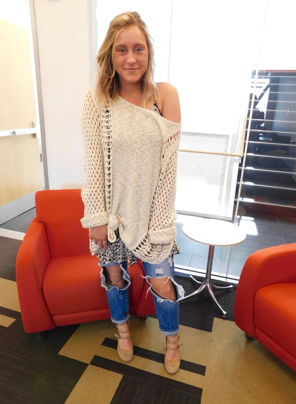 Jefferson University student Lauren looks relaxed in her ultra chunky knit sweater with various textures and designs, ultra destroyed denim boyfriend jeans, and round toe double-strap mary jane oxford heels.