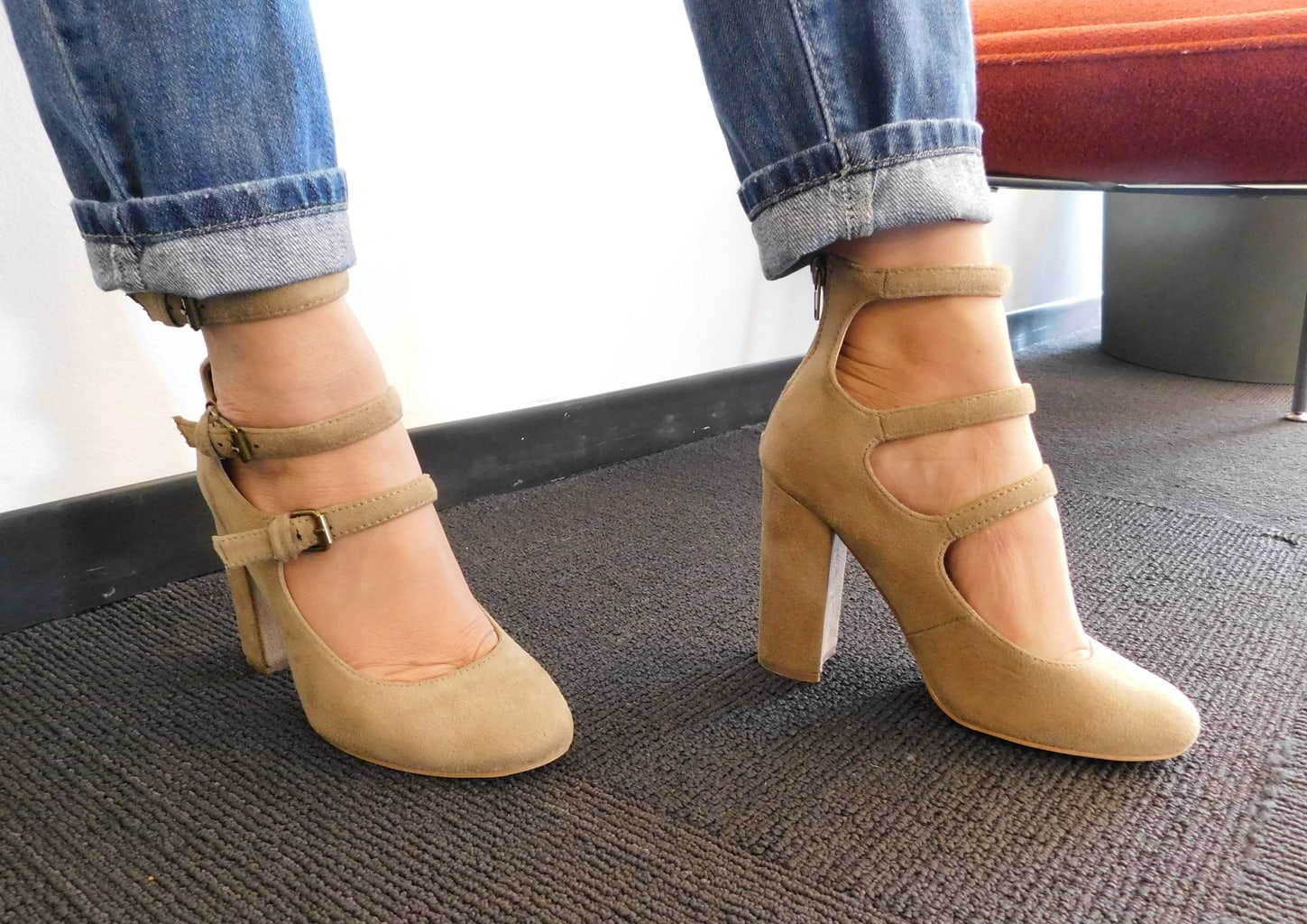 Lauren shows off her chunky-heeled mary jane inspired heels with three straps and silver buckles.