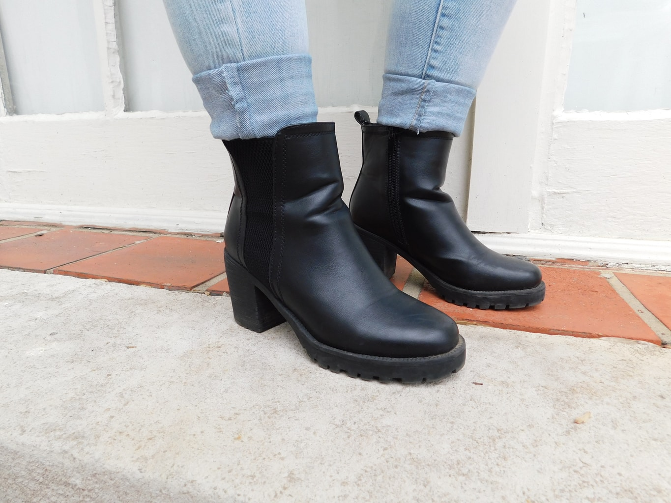 These black, chunky-heeled, rain boot style booties are a staple in Jackie's wardrobe.