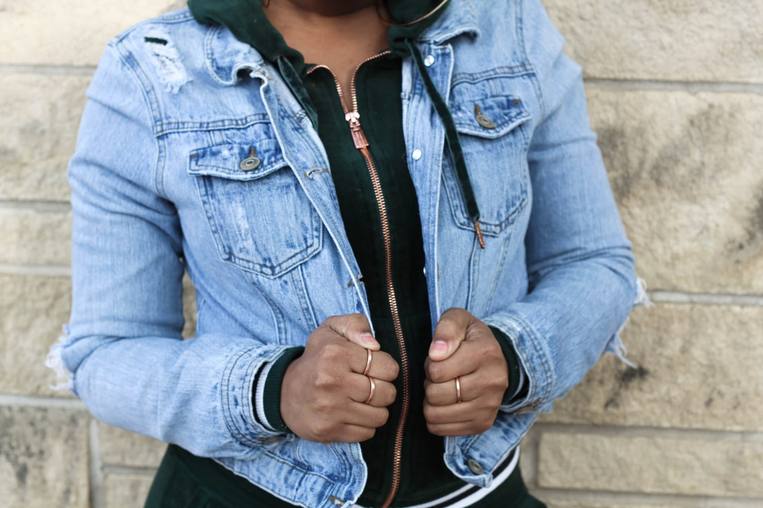Chaunice's emerald velour tracksuit hoodie with a rosegold zipper is grungier with her light denim jacket over the top.