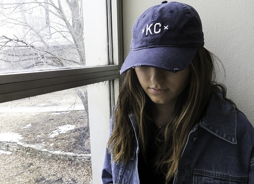 This soft blue KC hat is the perfect accessory for a Kansas girl having a messy hair day.
