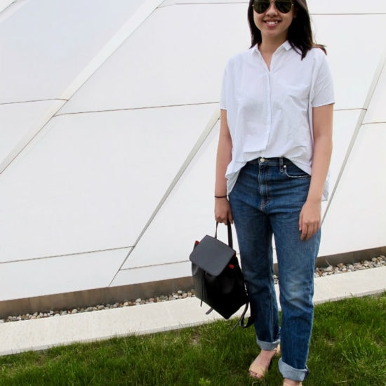 MSU fashion -- Student Julia wears boyfriend jeans, a white button down shirt, aviator sunglasses and strappy sandals, plus a minimalist black backpack