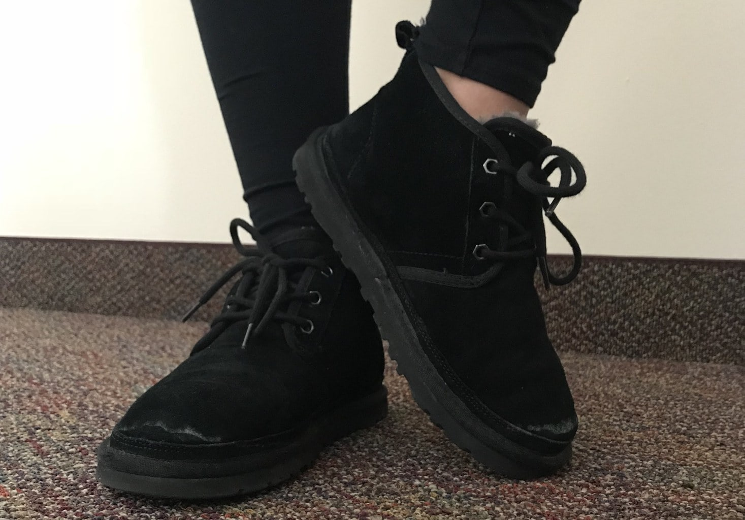 Arianna wears black velvety lace up sneakers with chunky rubber soles.