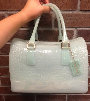 turquoise plastic purse