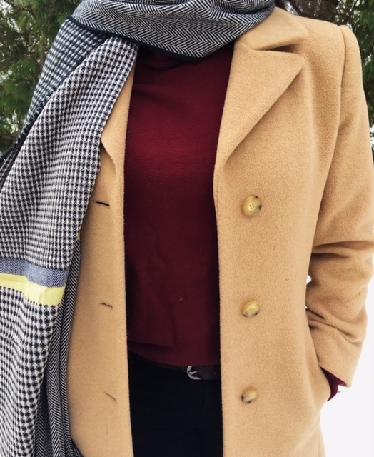 Shannon's tan peacoat pops against her burgundy turtleneck and black and white herringbone and checkered blanket scarf.