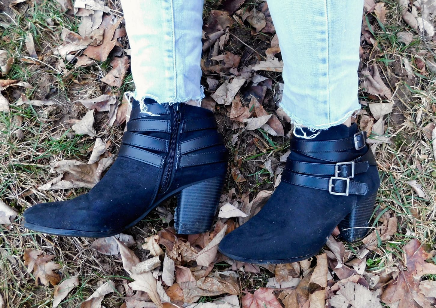 This student wears black chunky-heeled booties with straps and silver buckles.