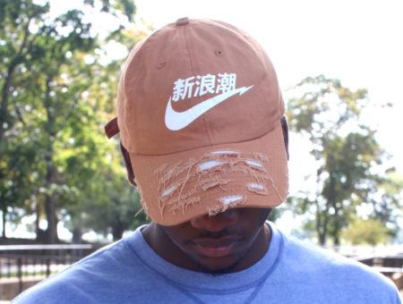 Custom screenprinted and shredded orange baseball cap.