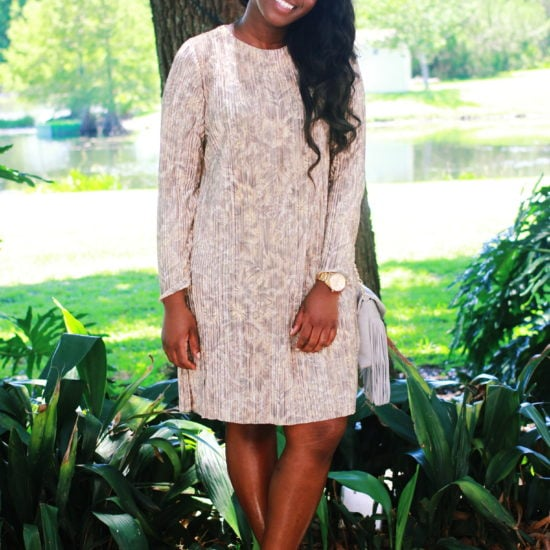 Church outfit: College student at UCF wears a long-sleeve cream dress to church with gold accessories and black pumps.