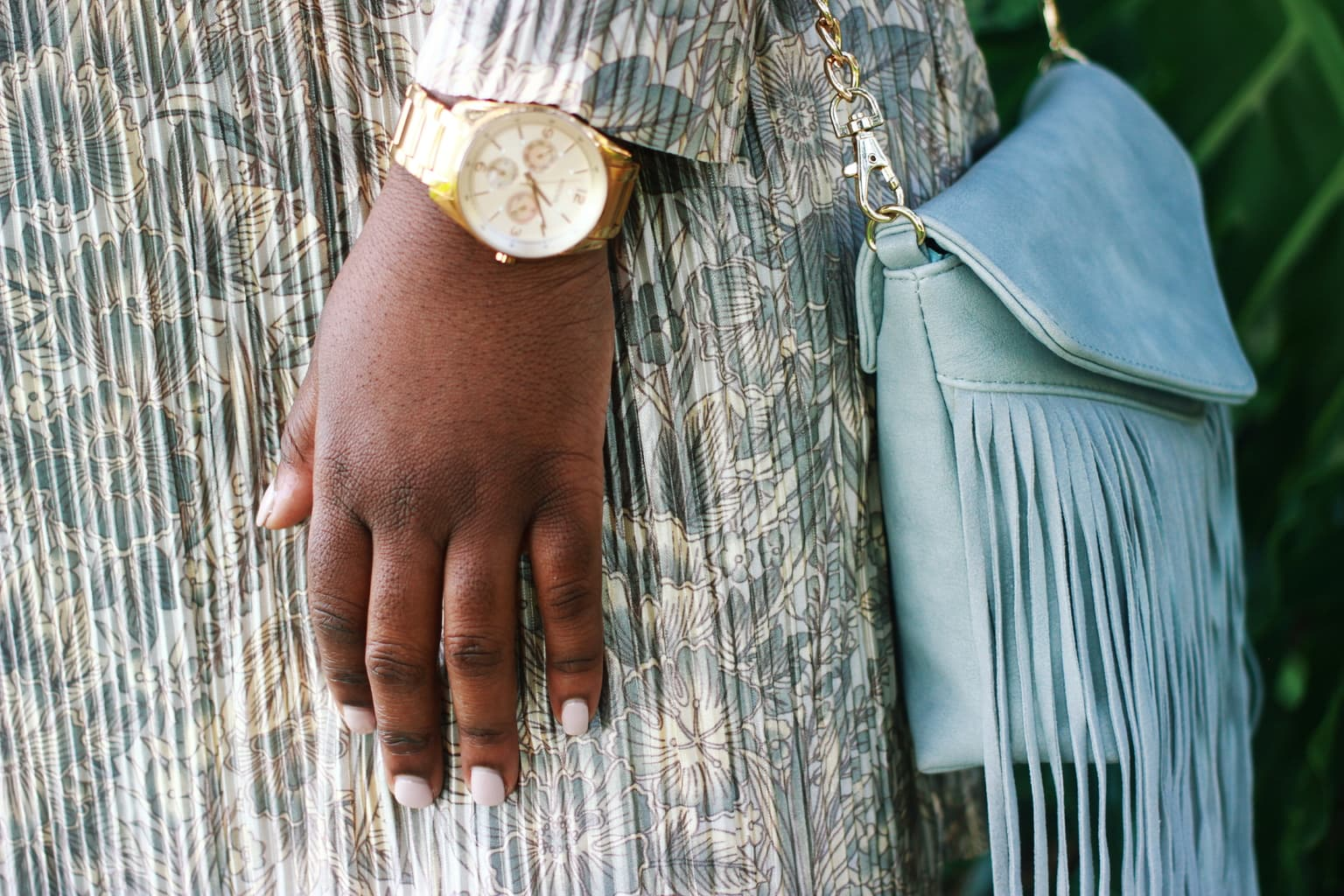 Large-faced gold watch and mint fringe mini purse with a gold chain accent this University of Central Florida student's pleated cream, blue, and gold dress, creating the perfect church outfit for Sunday.
