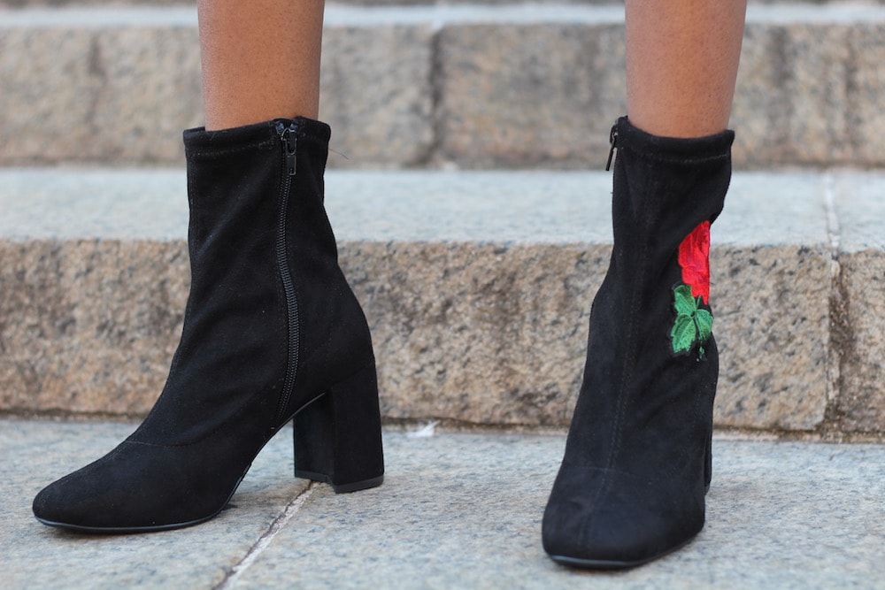 College fashion trends: Embroidered booties. College student fashionista from University of Missouri wears black suede booties embroidered with roses