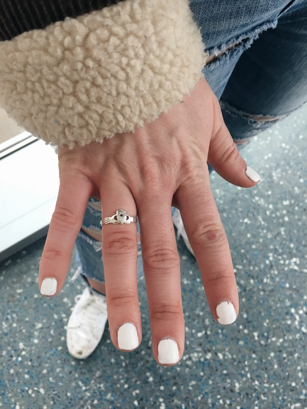 This dainty silver claddagh ring symbolizes Erin's relationship status.