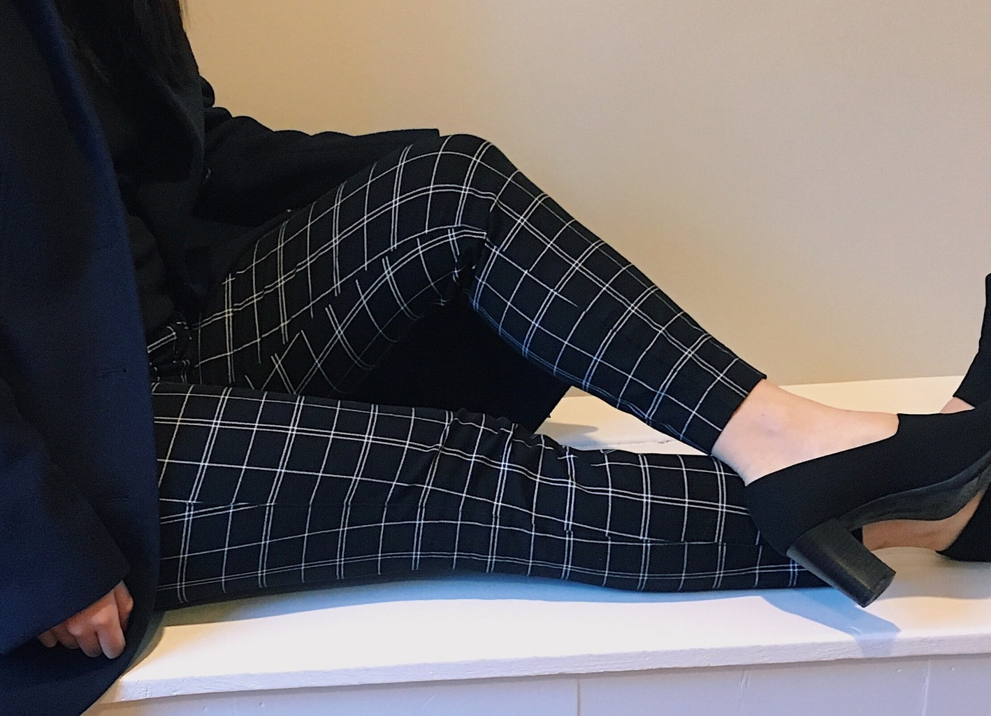 These black and white slim-fit pants are great for professional wear.