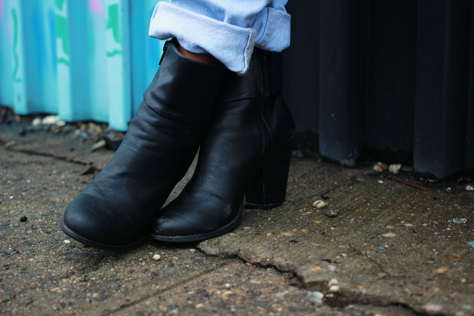 Student wears black chunky-heeled booties around campus for comfort and style.
