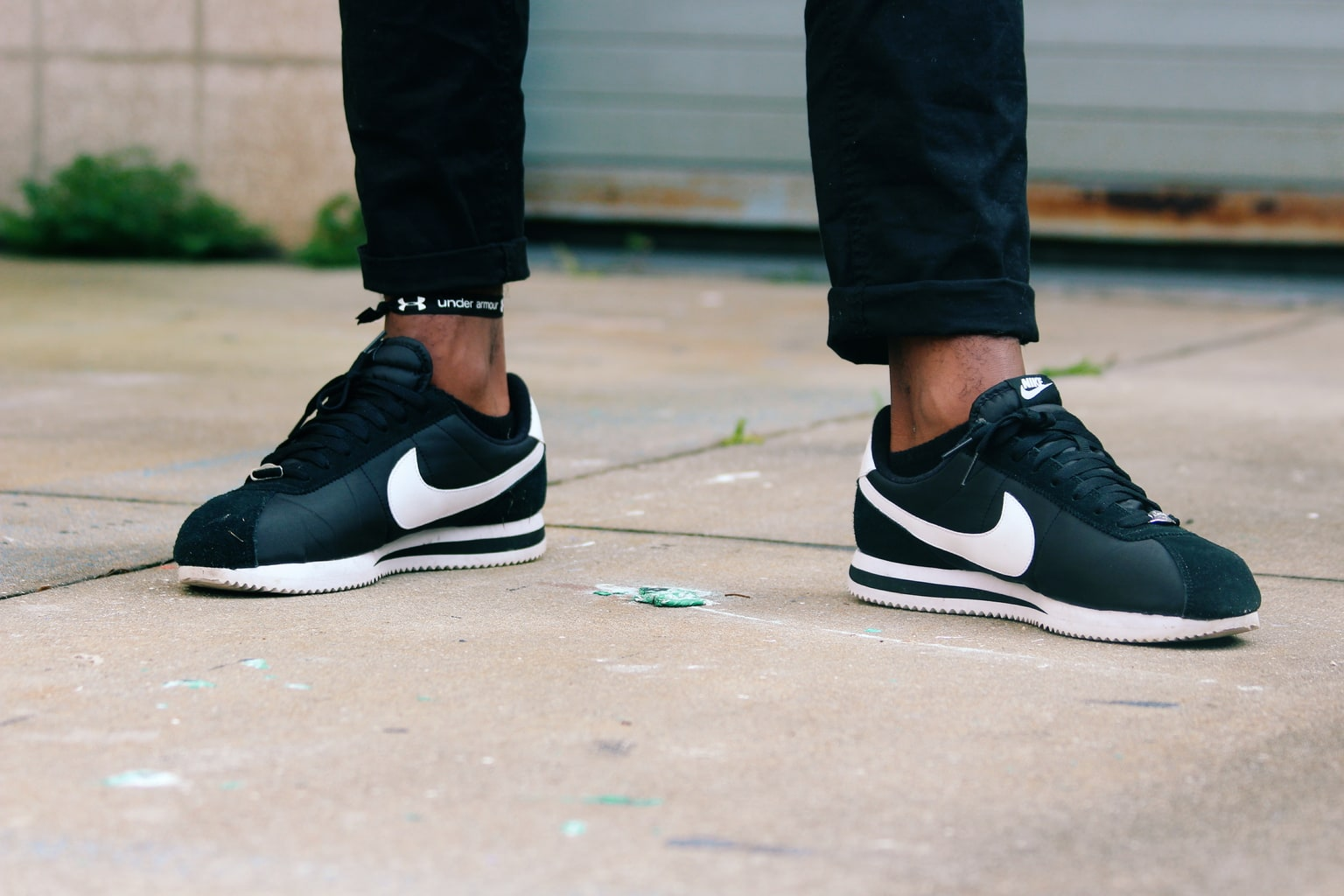 University of South Florida student wears a pair of black and white Nike Cortez lace up sneakers.