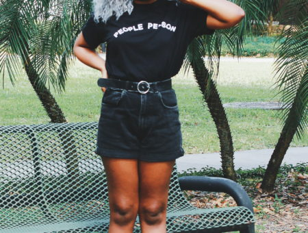 University of South Florida student Lundyn wears an all-black summer grunge look. Her tucked-in t-shirt reads