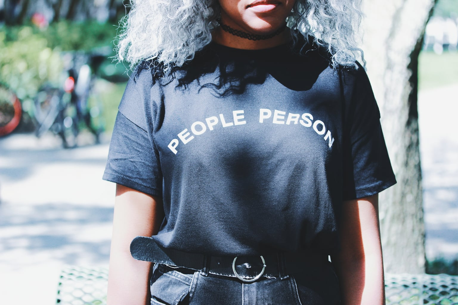 """Lundyn's unisex """"People Person"""" tee is tucked into high-waisted and belted boyfriend shorts and a choker necklace."""