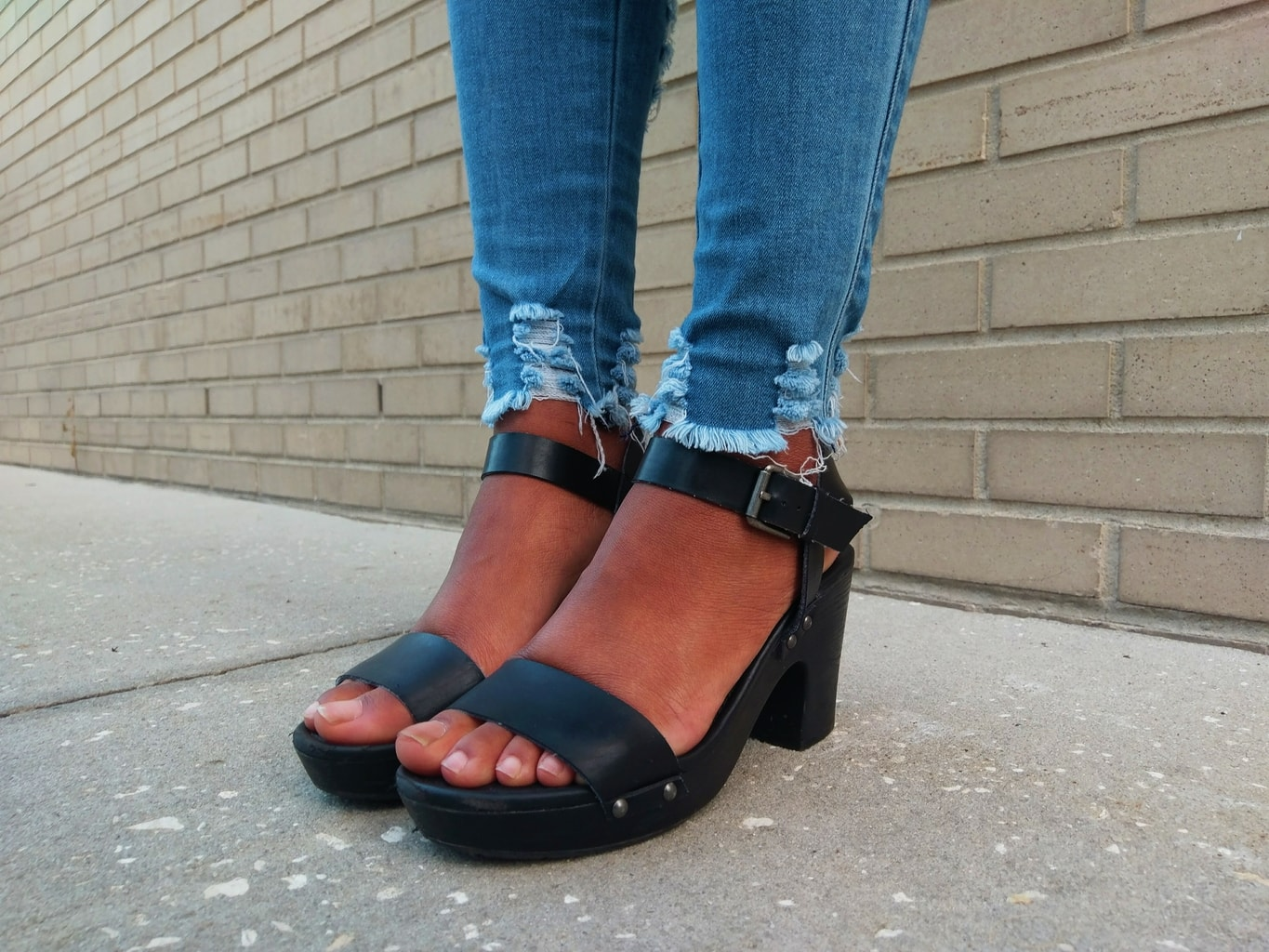 Payton's simple and chunky-heeled sandals have a one-inch platform and buckle straps around the ankle.