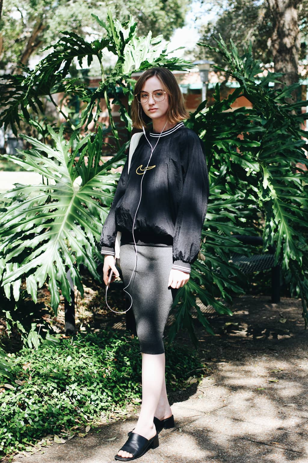 University of South Florida student Taylor wears a vintage oversized Nike athleisure pullover with a knit grey knee-length pencil skirt and chunky-heeled slip ons.
