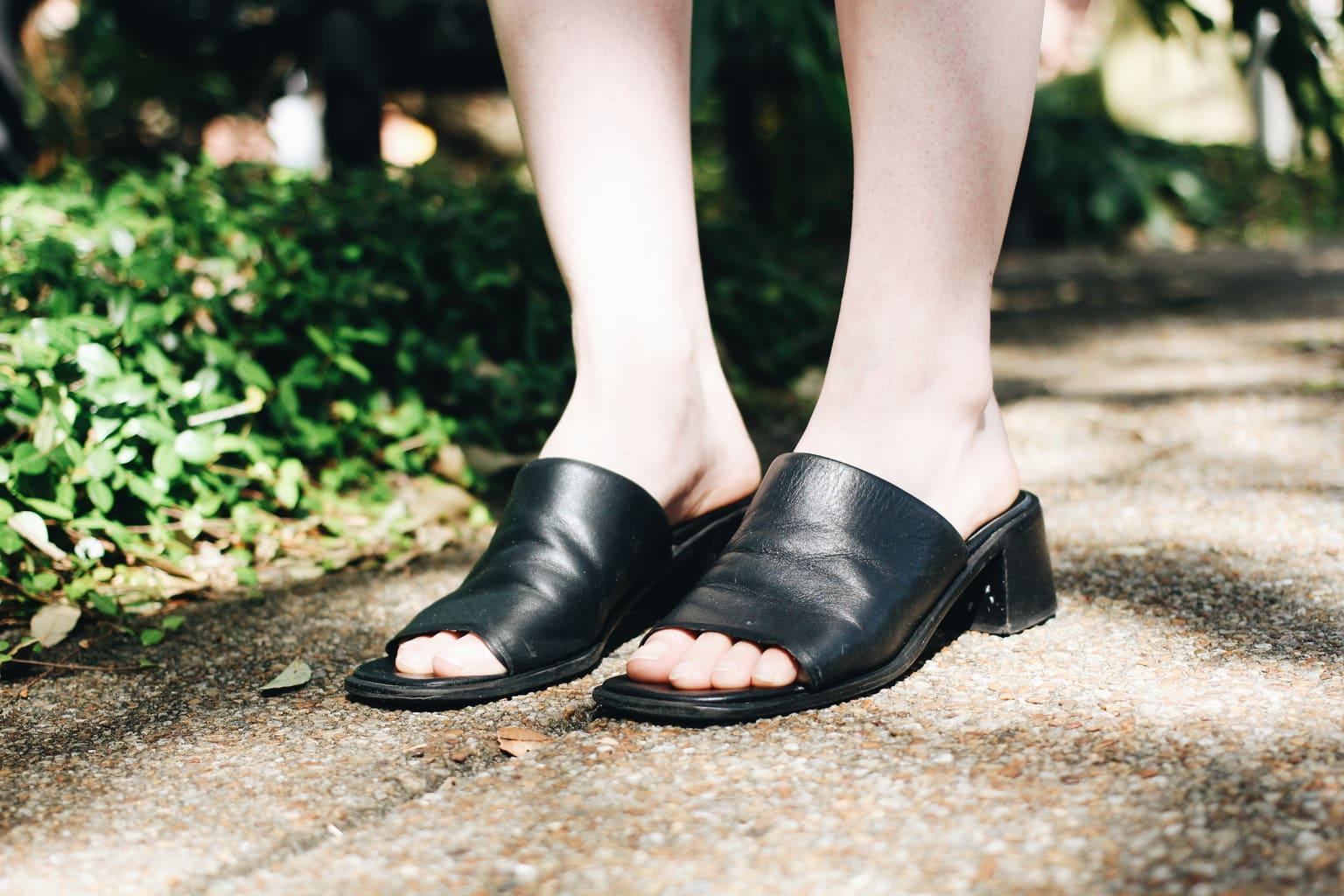 Chunky-heeled black slide-on vintage sandals.
