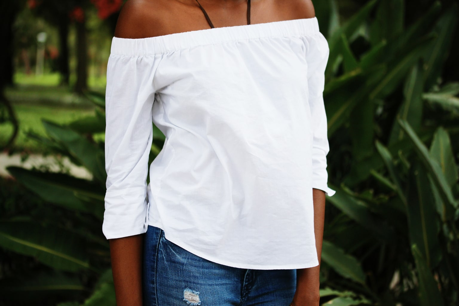 This off-the-shoulder white flowy top is great for warm weather days.