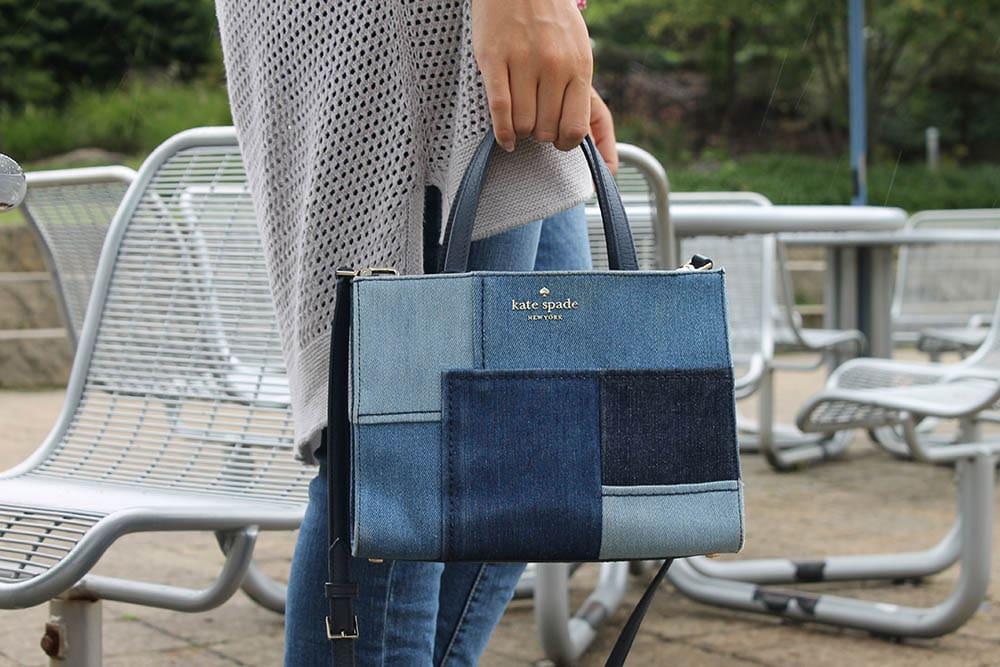 Alyssa wears a patchwork denim Kate Spade mini tote purse with a crossbody strap.