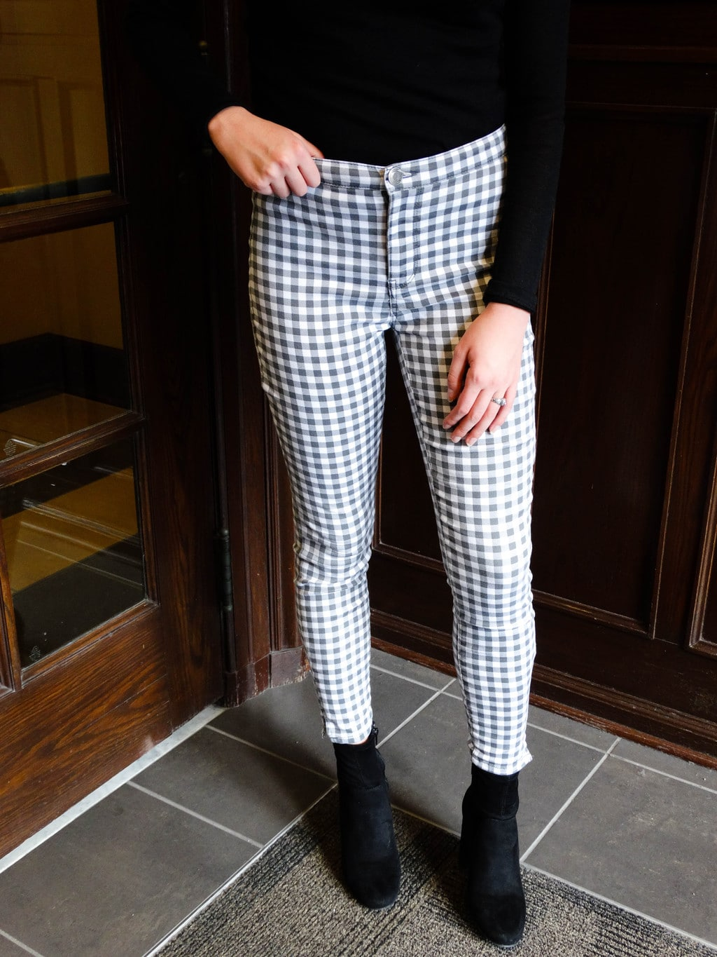 These form-hugging grey and white high-waisted checkered pants make a statement.