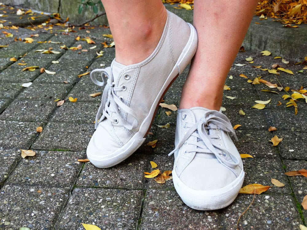 Light grey canvas lace-up sneakers, perfect for West Virginia University student Emma to wear on campus.