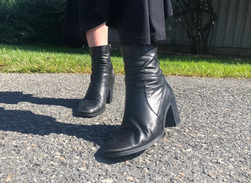 Georgia wears chunky black heeled ankle booties with side zippers and square toes.