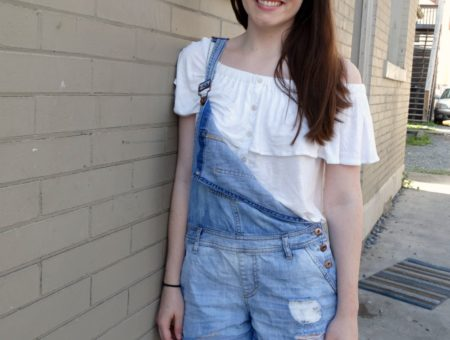 Street style: student at West Virginia University wears a white off-the-shoulder top with overall shorts