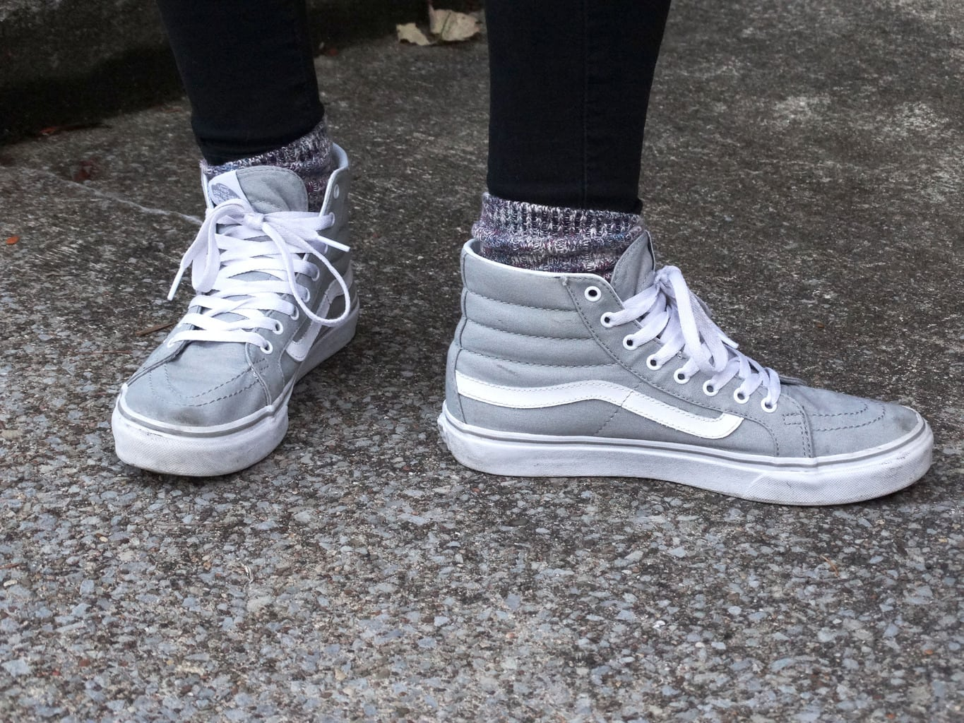 Sporty grey footwear for this West Virginia University student. She pairs these light grey hightops with chunky marbled socks peeking out of the top.