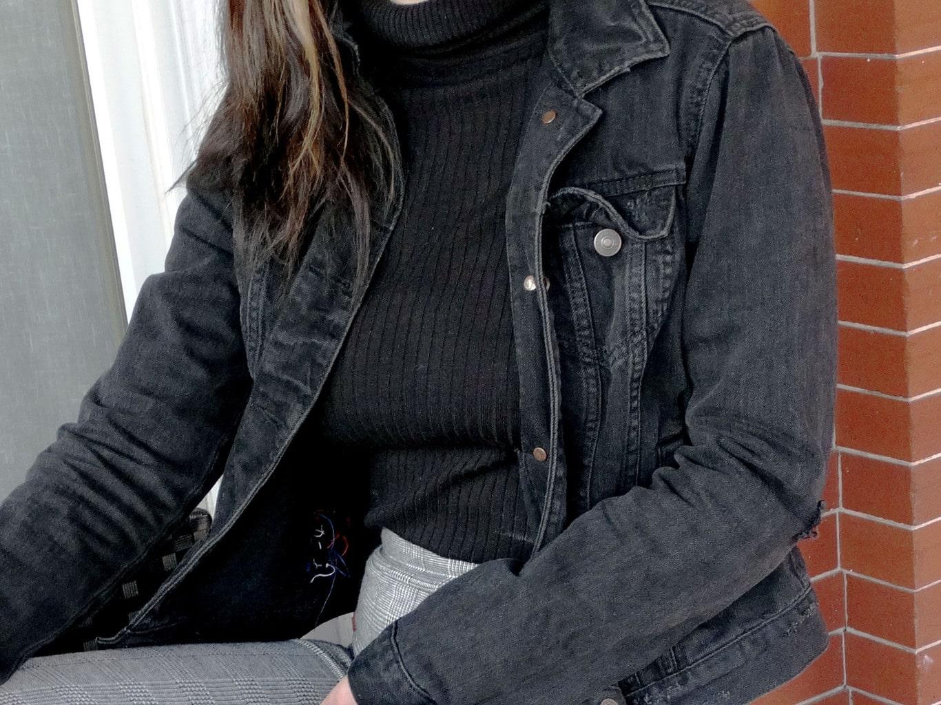 This grunge grey denim jacket accents Mackenzie's black turtleneck sweater.