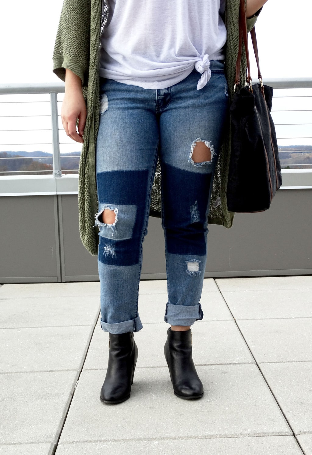 West Virginia University student Mel wears distressed patchwork boyfriend jeans cuffed to show off her chunky black booties.