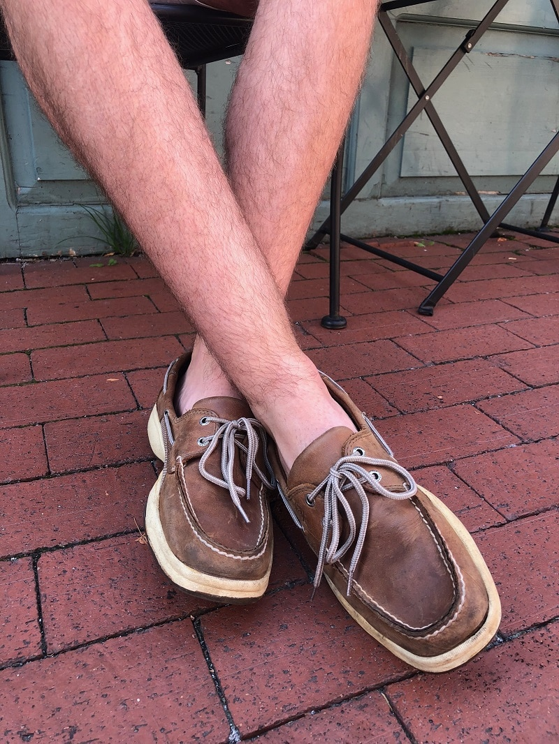 West Virginia University student Nathan wears brown leather Sperry boat shoes with light tan stitching and laces.