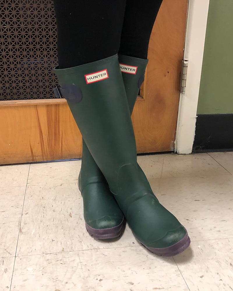 These original green rubber Hunter rain boots are an iconic footwear style.