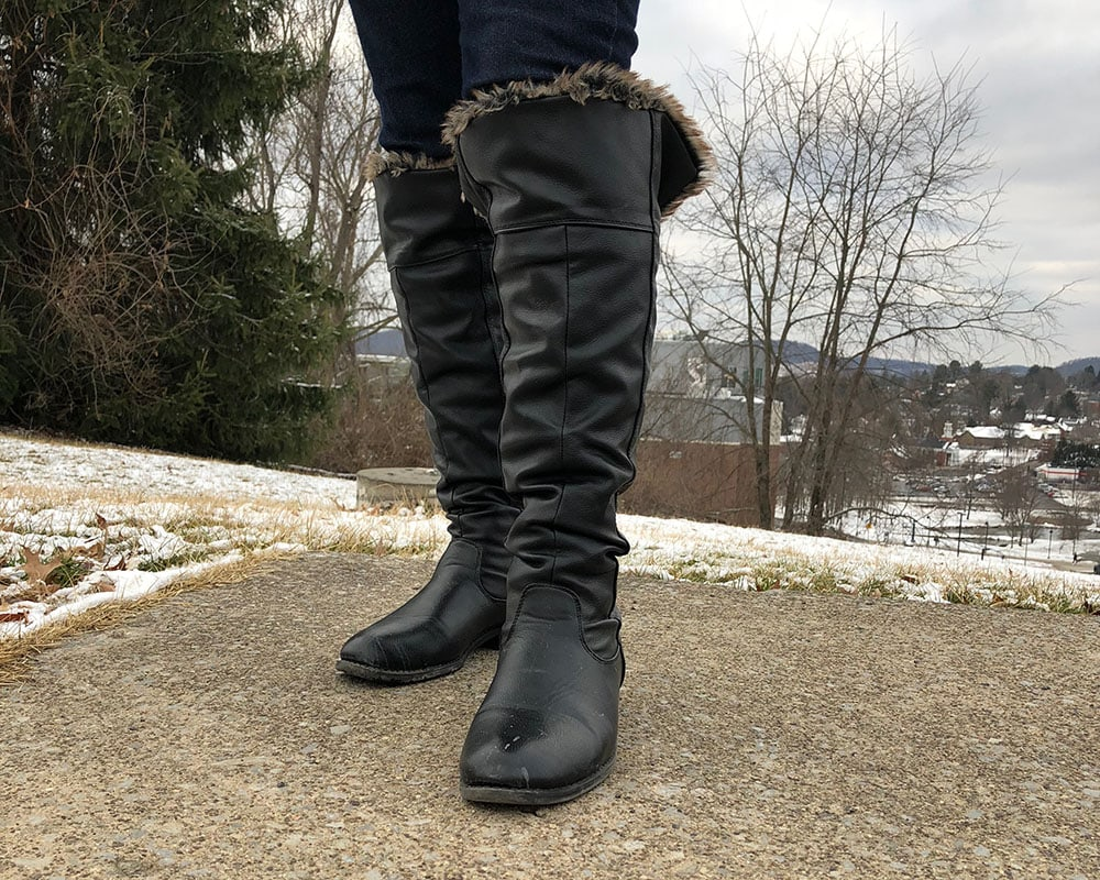 These flat black knee-high boots are lined with fur for cold and snowy days on campus.