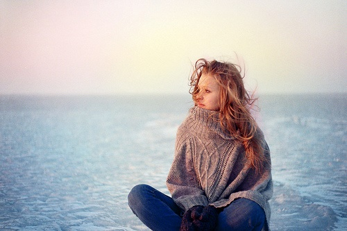 lonely girl in a giant sweater