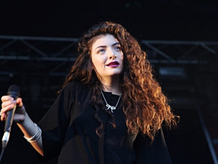 Lorde on stage, wearing all black