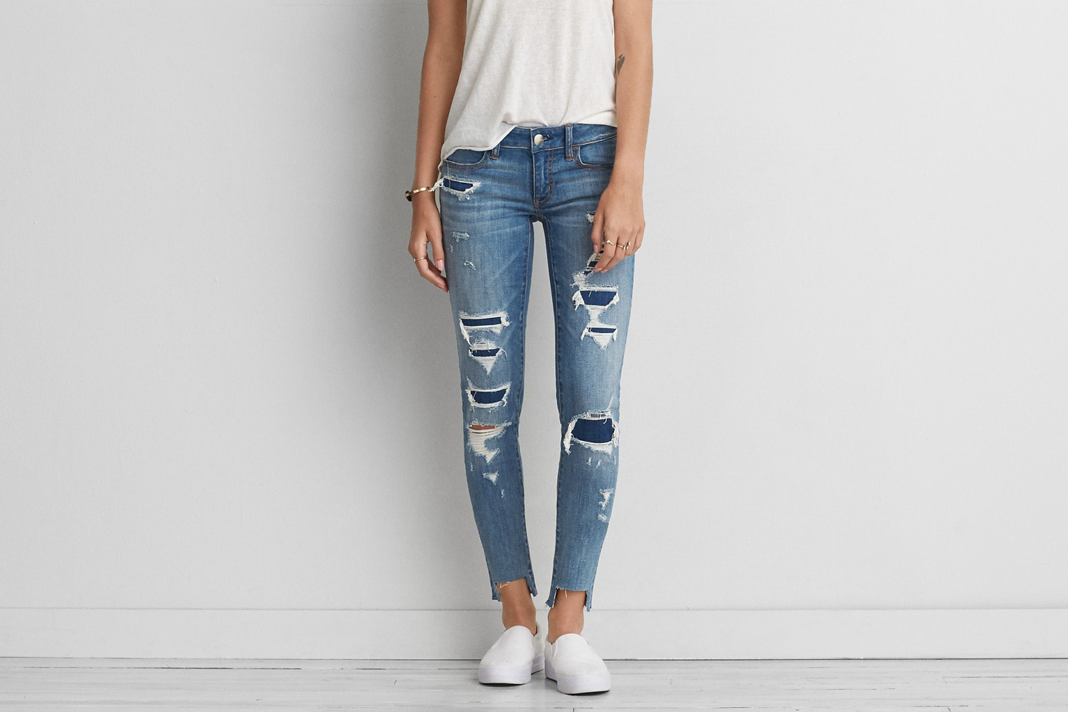 Distressed and patched skinny jean