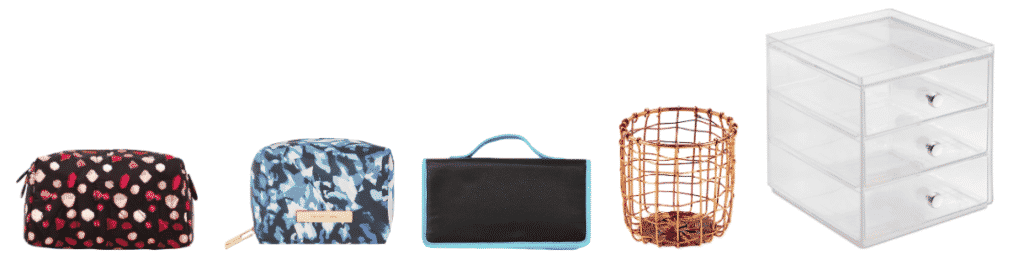 Black make-up bag with pink and red jewels, blue-and-green make-up case with gold hardware, black brush roll with aqua-blue trim, copper pencil cup, clear plastic triple-decker drawers