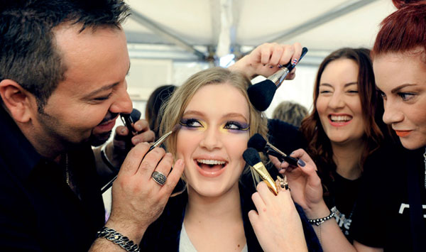 Makeup artists working on a model